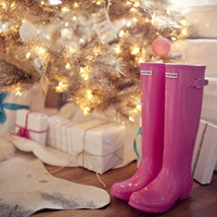 I wouldn't mind finding these boots under my tree on Christmas! And i love all the white and gold with little bits of hot pink & turq--- pondering my own christmas decor right now!