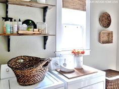 our vintage home love: laundry room -- nice shelves above washer and a wood countertop made for top of dryer, pretty even without front-loaders. Love the glass jars.