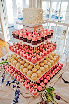 Cupcake tower topped with Cake