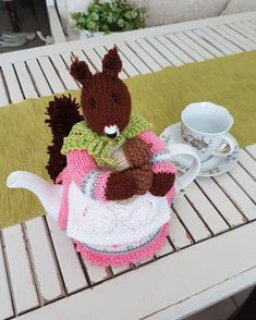 Knitting pattern for Beatrix Nutcracker Tea Cosy can be bought at www.tbeecosy.com: http://www.tbeecosy.com/product/beatrix-nutcracker-squirrel-tea-cosy