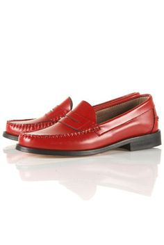Red leather penny loafers. J.W. Anderson.