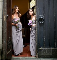 Bridesmaids dressed in purple and grey wedding theme