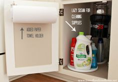Organizing Under The Kitchen Sink ~ like the idea of hiding the paper towels inside a cabinet!