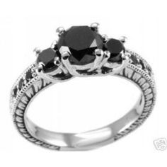 black engagement rings .