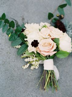 Classic pink and white rose bouquet with burgundy touches: http://www.stylemepretty.com/2015/11/30/marriage-matters-elegant-hometown-vow-renewal-in-atlanta/ | Photography: Sawyer Baird - http://sawyerbaird.com/