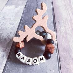 Personalised gift for baby, Teething ring, Wooden baby rattle, Flatlay prop, baby Christmas gift, deer teether, teether, Reindeer Teether by HopeDreamsJellybeans on Etsy https://www.etsy.com/uk/listing/558243815/personalised-gift-for-baby-teething-ring