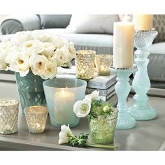 The soft, watery blues of our Matine Milky Glass Hurricane cast a pretty glow atop a table or mantel. Hand-crafted of glass with etched vine detailing. Entry Tables, Decorating Coffee Tables, Room Accessories, Ballard Designs, Vases, Hurricane Glass, Home Decor Inspiration, A Table, Sweet Home
