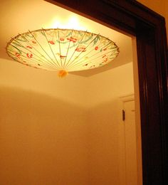 """8 Ways to Cover Ugly Light Fixtures """"Cover_up"""", """"Ugly"""", """"dorm"""", """"temporary"""", """"DIY""""] Change Light Fixture, Light Fixture Covers, Light Fixtures, Umbrella Lights, Paper Umbrellas, Do It Yourself Furniture, Sr1, Overhead Lighting, Decoration"""