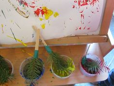 "Pine branch paint brushes as part of ""P is for Pinecone"" by #Teach#Preschool"