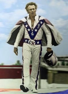 "Evel Knievel. ""He wore a cape ....you gotta have some huge balls, and do shit no one else does, to wear a cape, and not get laughed at....""  Craiger"