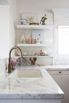 Kitchen Remodeling Countertops White kitchen with styled open shelves and white marble counter. - Create a chef-worthy space on a budget by incorporating kitchen styling ideas that will make your space look so expensive. Kitchen Tops, Kitchen Shelves, New Kitchen, Kitchen White, Paris Kitchen, Kitchen Sink, Kitchen Display, Stone Kitchen, Cozy Kitchen