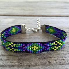 This bracelet was handmade by me in Cherokee, NC. Made from seed beads on a loom with a adjustable closure. Will fit wrist sizes 5.5 - 8+