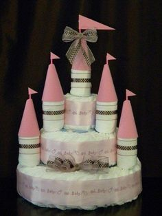 Castle Diaper Cake : Fit for a prince or princess, this castle diaper cake ($93) is capped off with five cones and waving flags for the full royal effect.