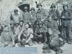 Part of the 82nd and 101st AB Divisions landed, by error, , 25 km away from their intended dropzone. These paratroopers stayed, from June 6th until June 20th, behind enemy line lines. On this photo they are finally joined by the troops of the 4th infantry Div... (Note the 2 German prisoners)