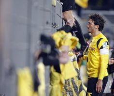 Dortmund defender Mats Hummels talks to supporters after defeat by Augsburg on Wednesday n...
