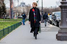 JJ Martin wearing a black coat outside Akris during the Paris Fashion Week Womenswear Fall/Winter 2016/2017 on March 6, 2016 in Paris, France.