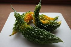 https://flic.kr/p/VSQ4KZ   bitter melon   one of summer delicacies cropped at our kitchen garden.