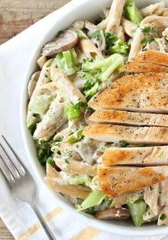 "Recipe: Chicken and Broccoli Penne Pasta | This recipe uses up ingredients I always try to have on hand because, together or separately, they seem to have infinite uses: chicken, broccoli, pasta. The pasta comes together with tangy cream cheese and the help of my favorite secret ingredient: starchy pasta water. The ""liquid gold,"" as I like to call it, helps create a luscious sauce so good you won't even miss the heavy cream."