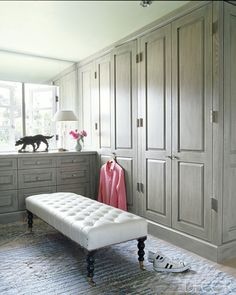 Amazing closet design!  Love the clothing behind closed doors, such a clean look.