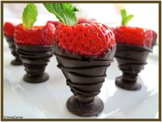 Chocolate dipped strawberry Jello shots....this sounds delicious. Fruit is healthy right????
