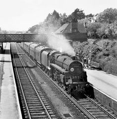 A BR Standard class 4 75065 pauses at New Milton with a Bournemouth to Eastleigh local service. Negative scan. Hampshire, England.