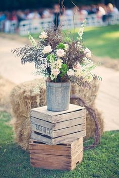 rustic wedding decorations - the foreground decor is beautiful and in the background the aisle looks cool too... looks like straw with a burlap runner over it, I love it... simple and rustic and beautiful!