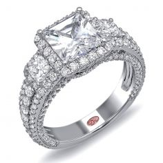 Available in White Gold 18KT and Platinum. Featuring a unique pink diamond in every one of the rings, symbolizing that hidden, unspoken emotion and feeling one carries in their heart about their significant other.      Demarco Bridal Ring.