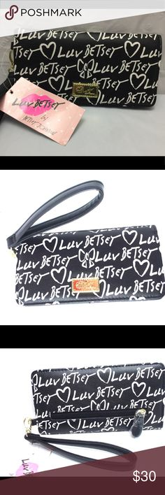 "Luv Betsey Black & White Logo Wristlet/Wallet New Luv Betsey by Betsey Johnson Logo Wristlet/Wallet Black/White  Product - Luv Betsey By Betsey Johnson Style - Wristlet Wallet Color - Black White Material - Faux Leather Measurement - 8"" Length x 4"" Height x .5"" Depth Betsey Johnson Bags Wallets"