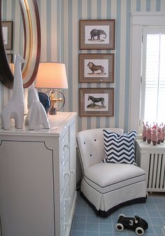 Different color blue stripes on the wall with the fireplace. I love this for the boys room!