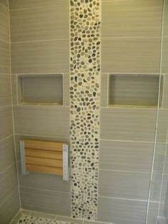 Teak bench in shower. Natural elements with a contempory look.