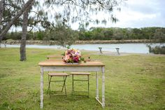 Wedding ceremony registry set- bistro chairs with rustic wooden table with white legs
