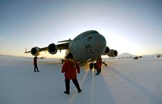 A loadmaster and maintenance members conduct preflight checks on a C-17 Globemaster III before taking off on an Operation Deep Freeze winter fly-in mission Aug. 25 from Pegasus White Ice Runway, Antarctica. A C-17 and 31 Air Force Reserve and Regular Air Force Airmen from McChord Air Force Base, Wash., conducted the annual winter fly-in augmentation of scientists, support staff, food and equipment for the U.S. Antarctic Program at McMurdo Station, Antarctica.
