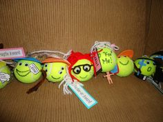 "Customized tennis buddies.  Each one reflects the ""tennis""personality of someone on our team.  Big hit as an end of season gift."
