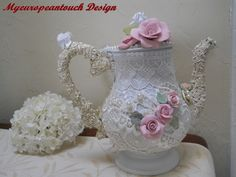 "FREE US SHIPPING Shabby Chic Altered Lace Teapot Center Piece, I transformed a tarnished teapot called ""Camille"" into this fanbulous Shabby Chic Center Piece. It is covered with at least 8 different laces, lots of pearls and rhinestones, this pot is blinged out. Colors are Ivory, Cream and White. I sanded, primed and painted this …"
