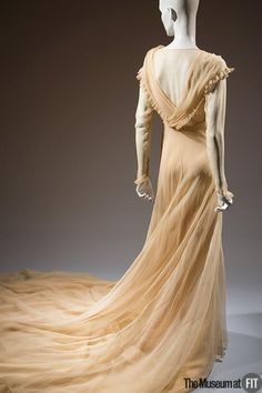"""Circa 1937 Wedding Dress."" Ooh, I love the train on this. The fabric color and drape are lovely as well."