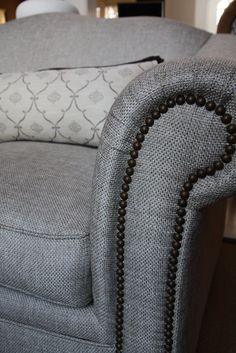 reupholstered sofa with long pillow                              …