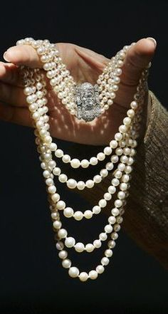 """Princess Margaret's Art Deco Pearl and Diamond Necklace."""