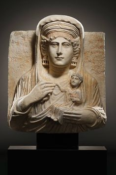 A FUNERARY RELIEF OF A LADY H. 56 cm. Limestone, red paint Palmyra, 2nd half 2nd-1st half 3rd cent. A.D.