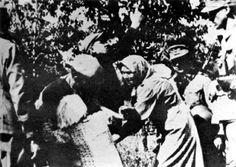 Nazi soldier kidnapping a Polish child for the Lebensborn  program