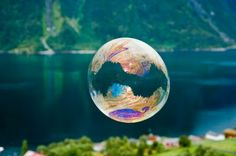 Norwegian photographer Odin Hole Standal woke up early one morning, went outside and made giant soap bubbles. Beautiful!