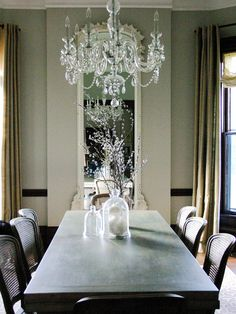 Silver Gray: A Romantic Feel  A lighter shade of gray brings a romantic touch to a space. This dining room, designed by Rebekah Zaveloff, features silver-gray walls for a sophisticated, inviting look. The dark gray table draws the eye toward the center of the room.