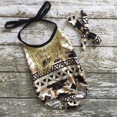 This foxy romper is made for the littlest diva! Gold fringe and trendy aztec pattern for your fashionista! Soft stretchy material. Headband included!