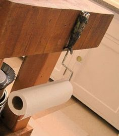 Repurpose old paint roller into paper towel holder