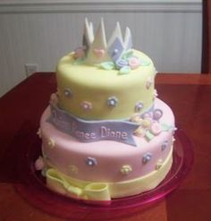 elegant princess baby shower cake with lavender and cream layers and crown on top