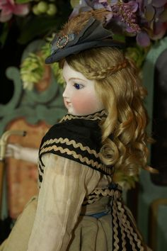 Hand-wefted mohair doll wig with side braiding and long curls.