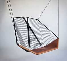 If It's Hip, It's Here: The Solo Cello, A Modern Steel and Leather Hanging Chair by Felix Guyon.