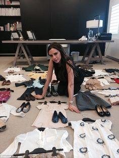 This exclusive snap released to promote the sale shows Victoria picking out the outfits