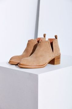 e68e7c58038 Slip-on suede ankle booties from Jeffrey Campbell with notched cutouts at  each side. Trimmed with a chunky stacked wooden heel.