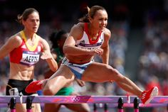Jessica Ennis of Great Britain competes in the Women's Heptathlon 100m Hurdles Heat 1 on Day 7 of the London 2012 Olympic Games at Olympic Stadium on August 3, 2012 in London, England