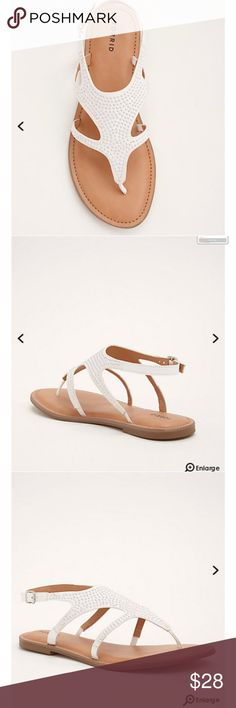 Studded T-Strap Sandals (Wide Width 11 Studded T-Strap Sandals (Wide Width  Let your sandals steal the spotlight for a change! These white faux suede T-strap sandals bling-bling in the sunshine thanks to the silver tone studs dotted all over.  TRUE WIDE WIDTH: Designed so you never have to size up again.Man-made materialsImported torrid Shoes Sandals